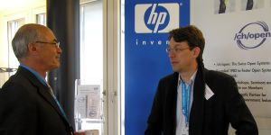 Peter Stevens, another member of the /ch/open board, talking to a visitor